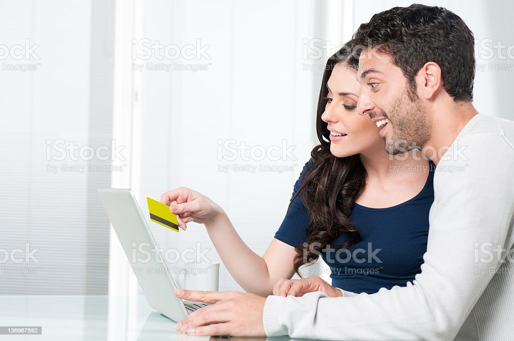 Surpised couple internet shopping royalty-free stock photo