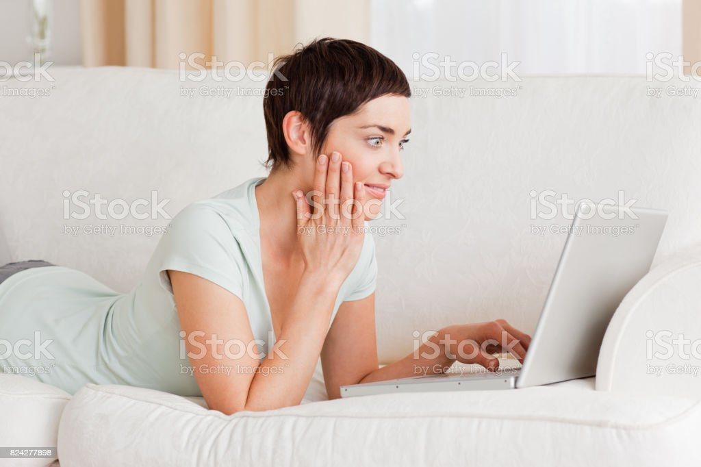 Surpised woman using a laptop stock photo