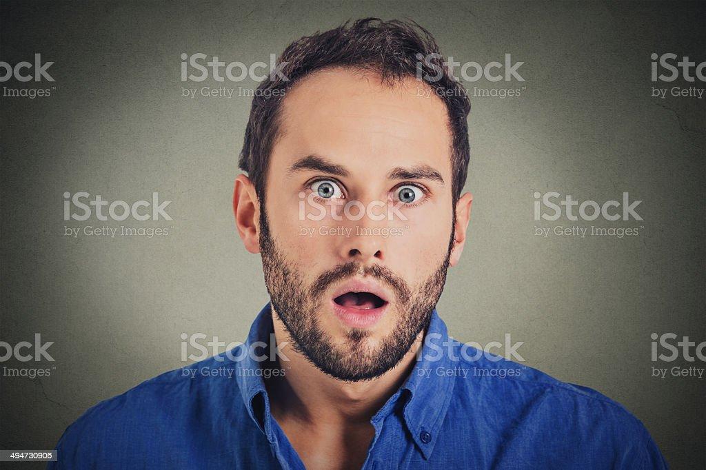 Surprise astonished man. man looking surprised stock photo