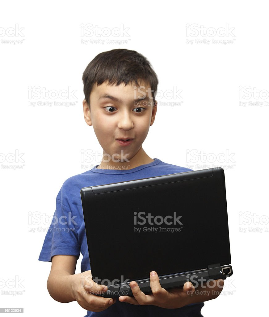 surprise boy with laptop royalty-free stock photo