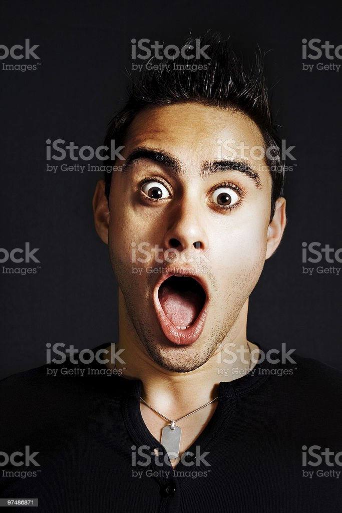 Surprise concept - amazed funny young man royalty-free stock photo