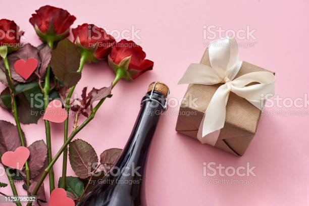 Surprise for her special gift box with white ribbon red roses and picture id1129798032?b=1&k=6&m=1129798032&s=612x612&h=otqs7fbps3o22ngknpmdep41nufsphg7ox5pidiw0jo=