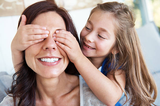 surprise from a loved one - mom spying stock photos and pictures