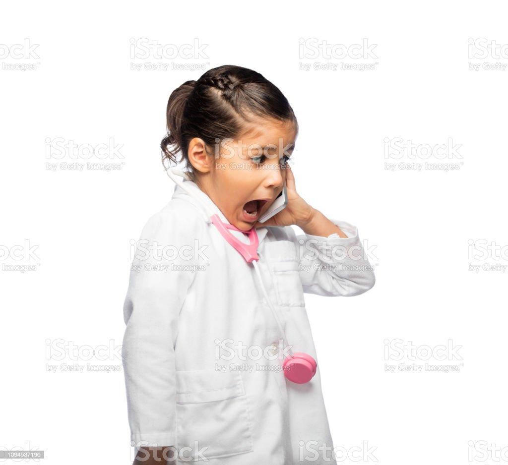 Surprise little girl talking on cellphone stock photo