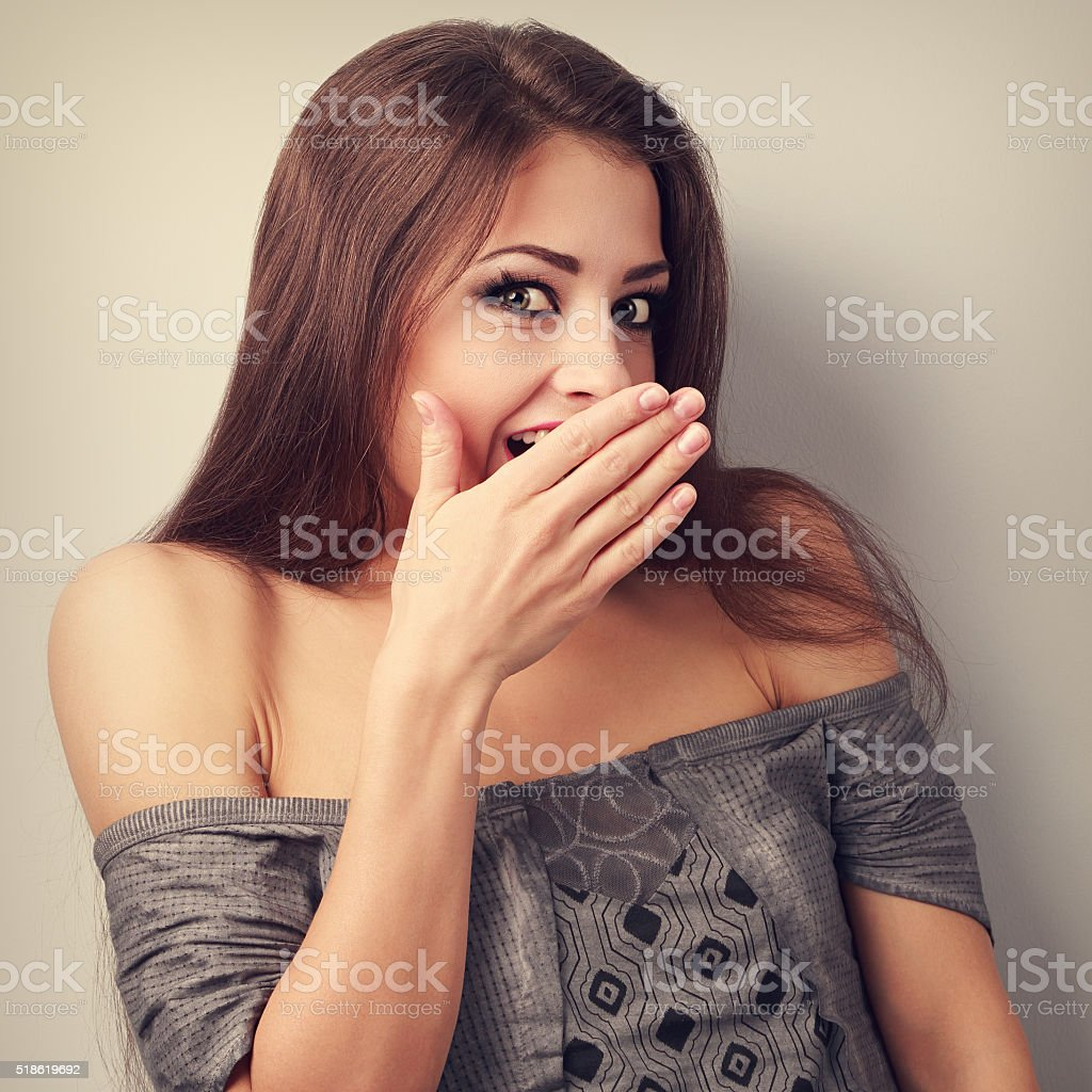 Surprise makeup woman cover mouth the hand and looking stock photo