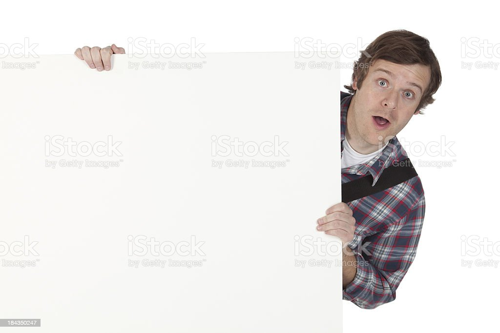 Surprise man behind a placard royalty-free stock photo