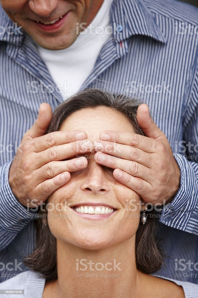 Surprise - Man covering mature woman's eyes royalty-free stock photo