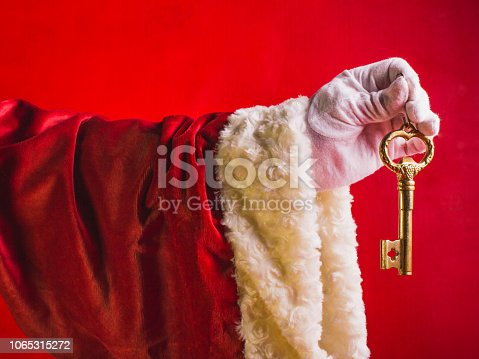 istock Surprise of Santa Claus a key from new house. Happy New Year! Concept new dwelling. 1065315272