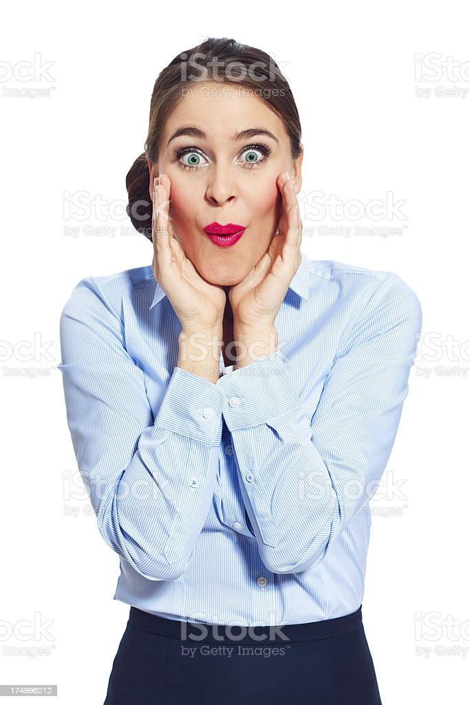 Surprise Portrait of surprised businesswoman standing against white background and staring at the camera. 20-24 Years Stock Photo