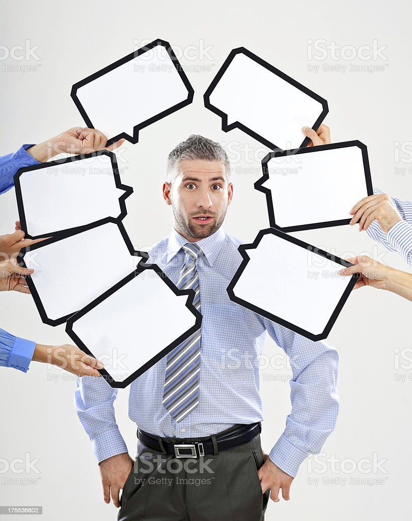 Surprise Portrait of surprised businessman surrounded by many speech bubbles with copyspace. 30-34 Years Stock Photo