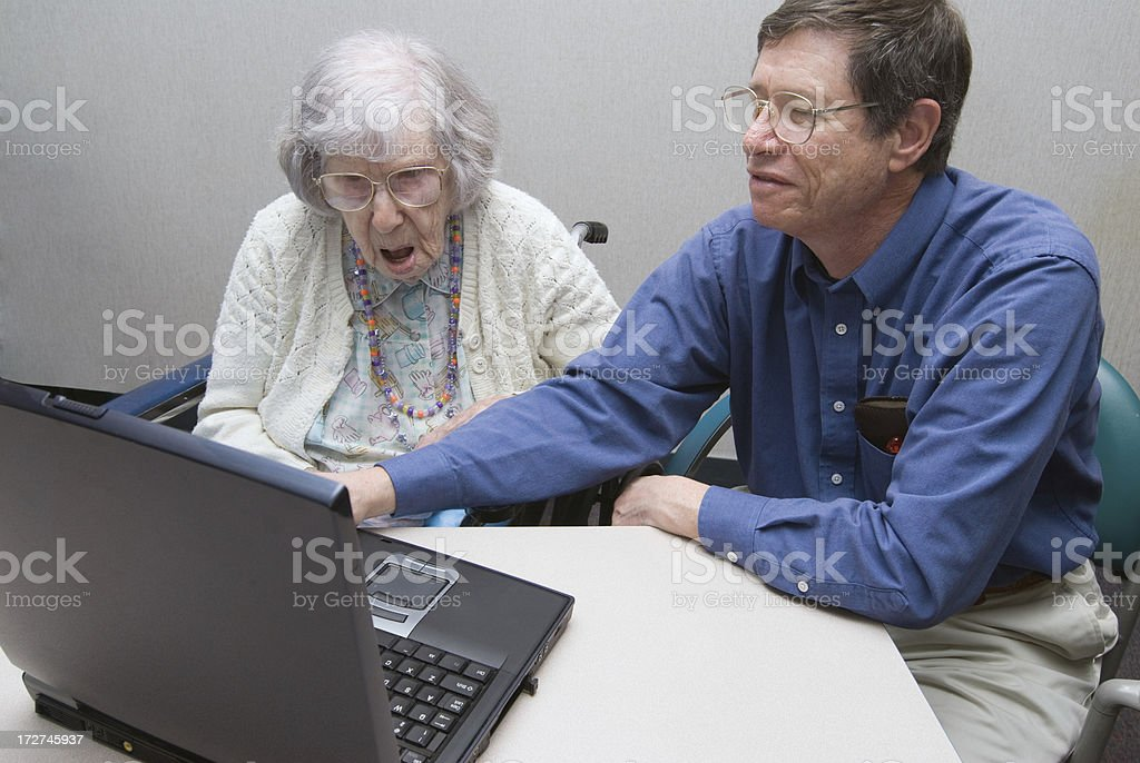 Surprised 100-year-old Woman Learns About Computers stock photo