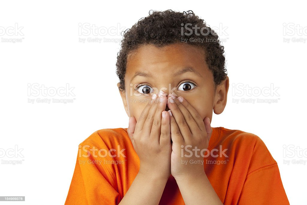 Surprised 8-year old mixed race boy on white stock photo