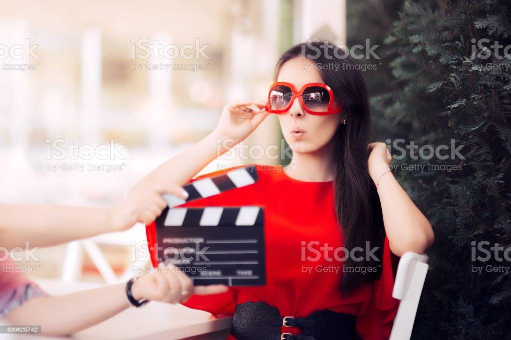 Surprised Actress with Oversized Sunglasses Shooting Movie Scene - foto de stock