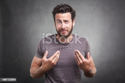istock Surprised adult asking you mean me? 496730994