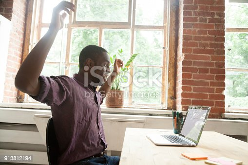 istock Surprised african-american man excited by online win looking at laptop 913812194