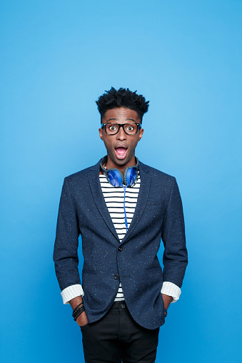 Surprised Afro American Guy In Fashionable Outfit Stock Photo - Download Image Now