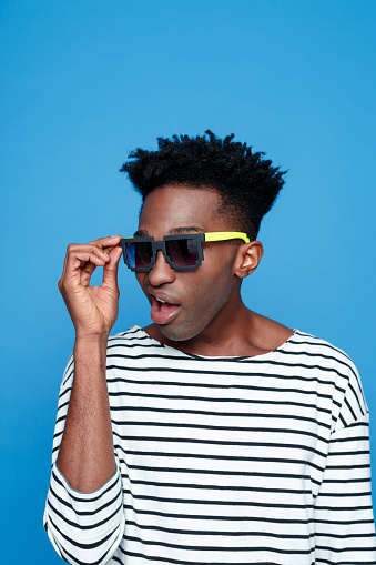 Surprised Afro American Guy Wearing Sunglasses Stock Photo - Download Image Now