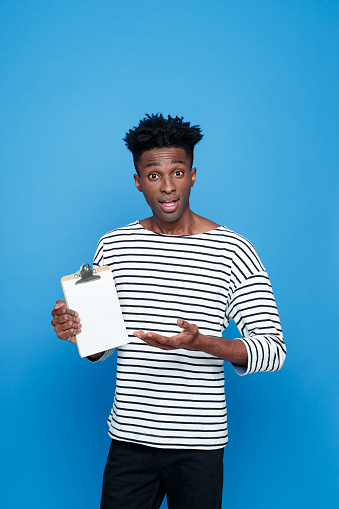 Surprised Afro American Holding Clipboard Stock Photo - Download Image Now