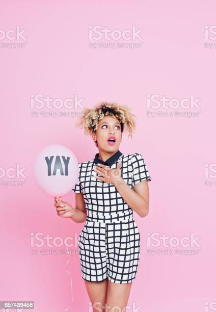 Surprised Afro American Woman Holding Pink Balloon Stock Photo - Download Image Now