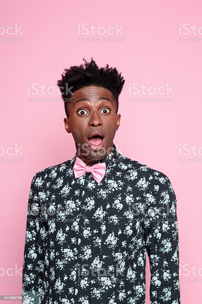 Surprised afro american young man stock photo