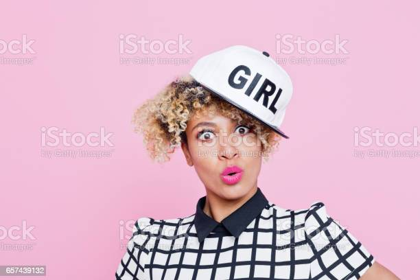 Surprised Afro American Young Woman Wearing Baseball Cap Stock Photo - Download Image Now