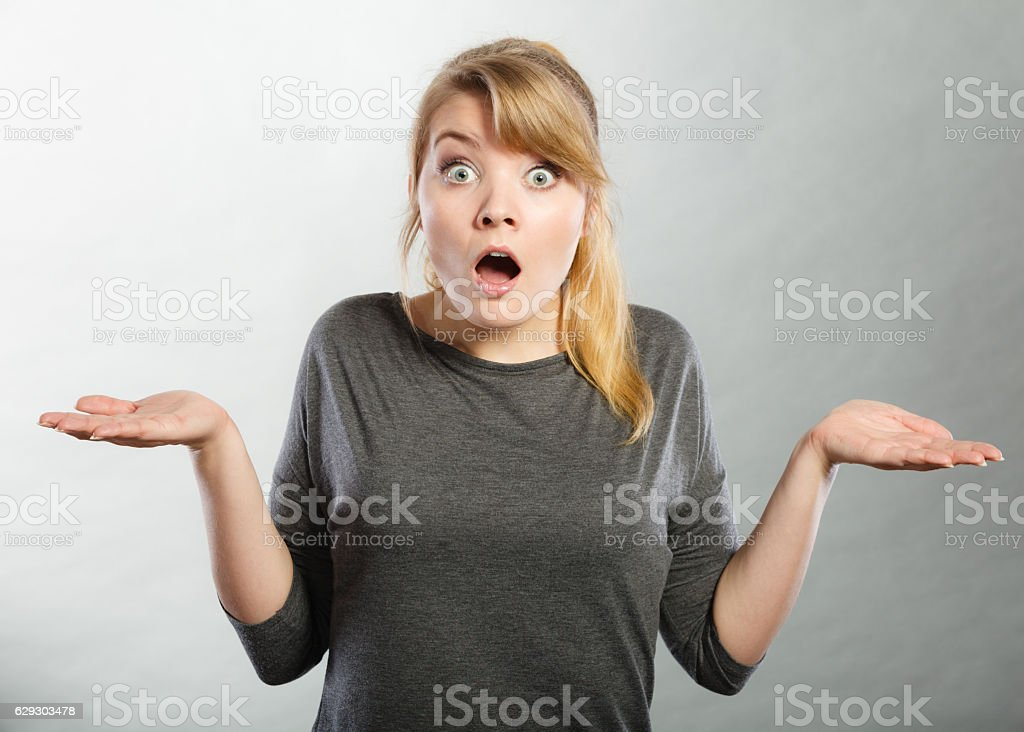 Surprised astonished girl with open mouth. stock photo