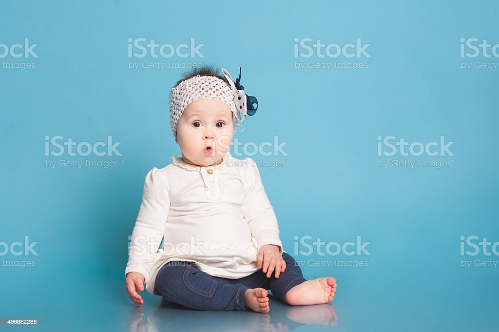 Surprised baby girl stock photo