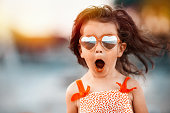 istock Surprised baby girl wearing heart shaped glasses 1294927798