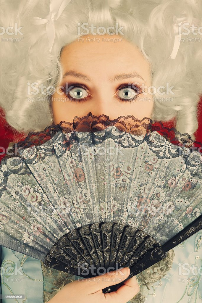 Surprised Baroque Woman Portrait with Wig and Fan stock photo