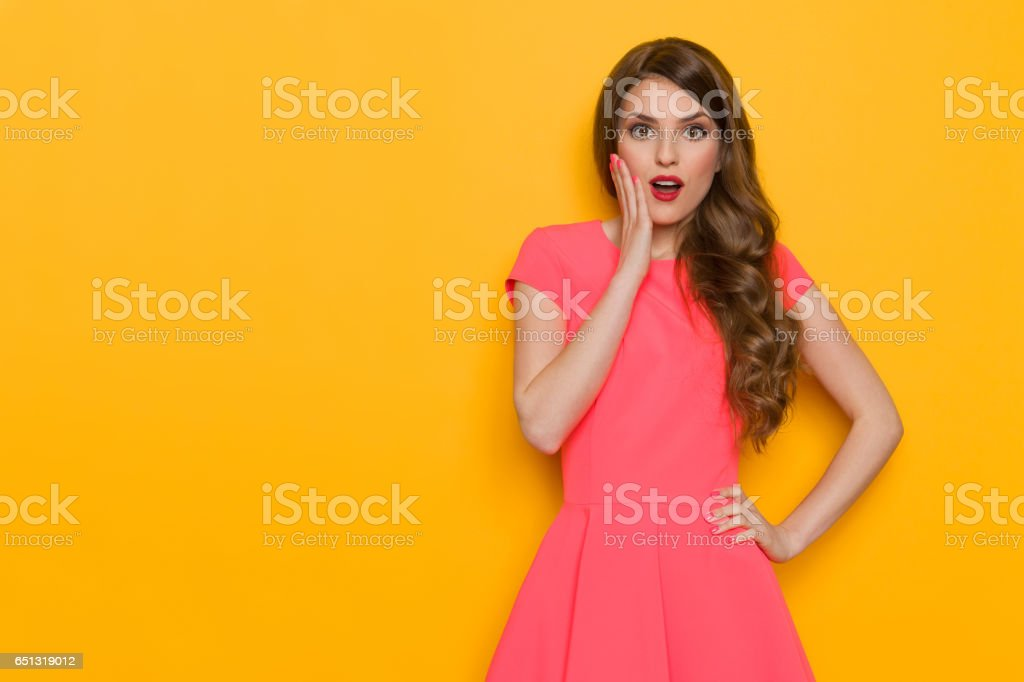 Surprised Beautiful Elegant Woman In Pink Dress stock photo
