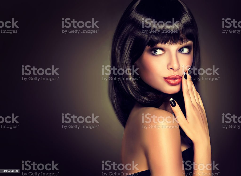 Surprised beautiful girl look aside.Black hair and a black manicure. stock photo