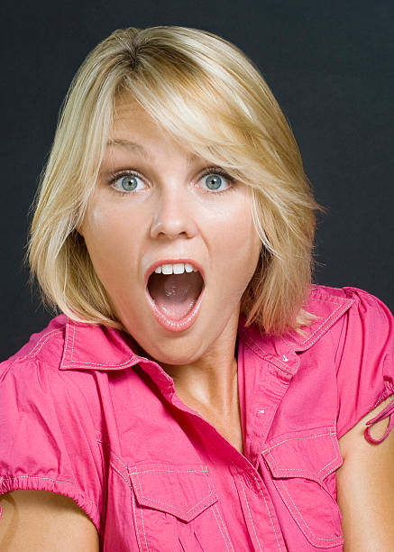 surprised beautiful young blonde woman in pink - omg stock photos and pictures