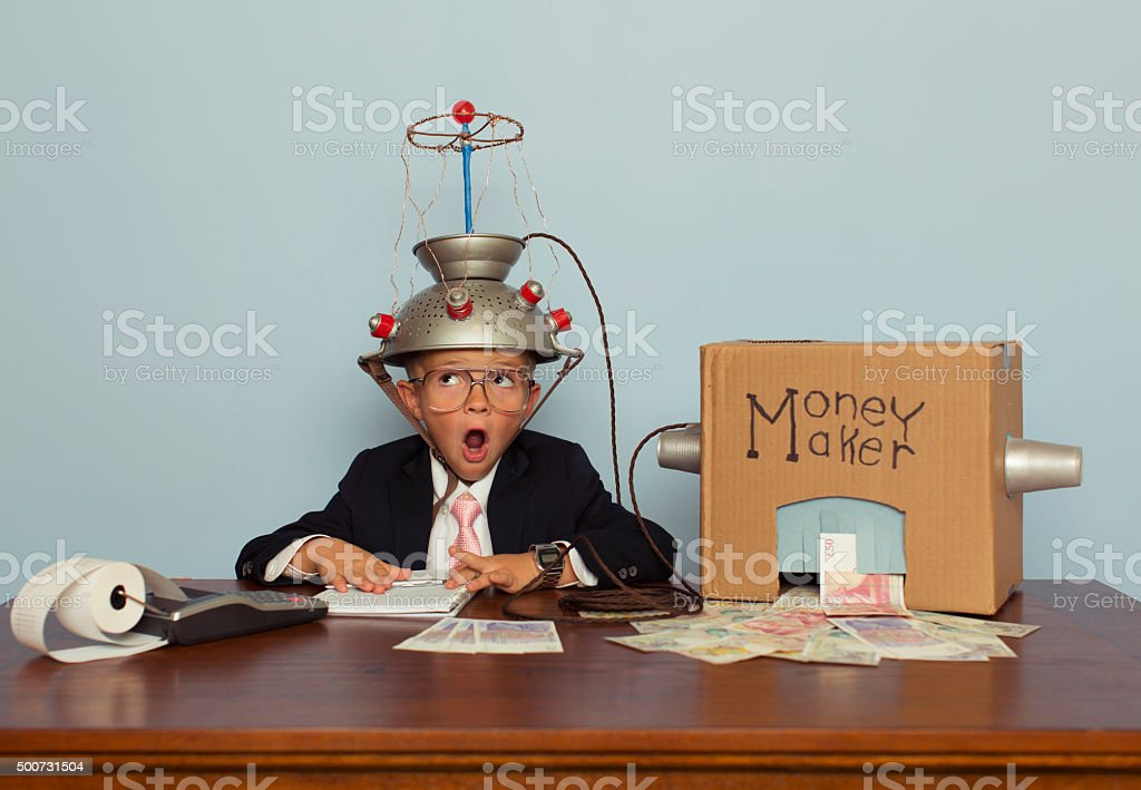 Surprised Boy Makes Money with Idea Helmet stock photo