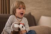 Surprised boy watching TV