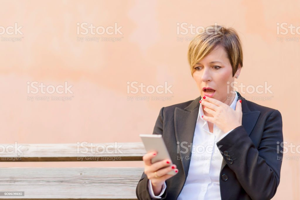 Surprised business woman calling by phone outdoor royalty-free stock photo