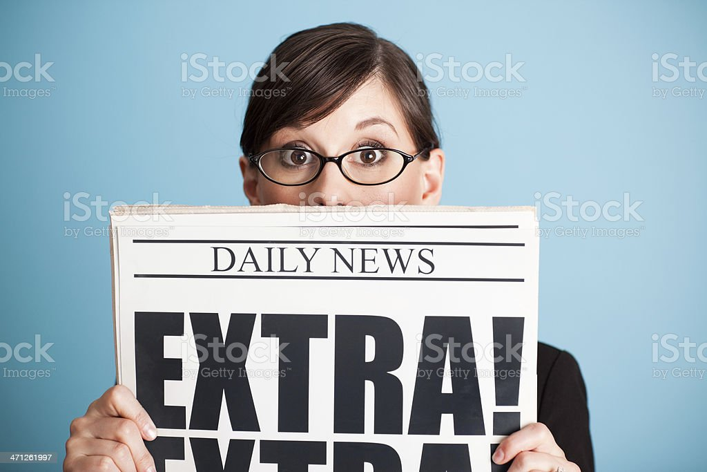 Surprised Business Woman Holding Newspaper with Extra! Headline - Royalty-free 20-29 Years Stock Photo