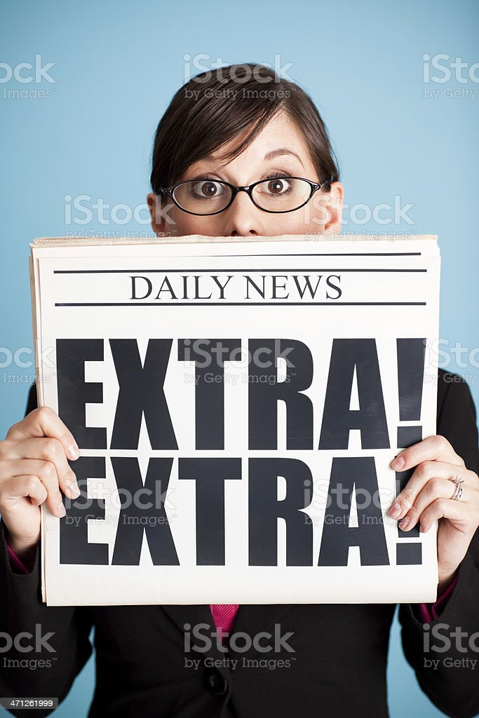 Surprised Business Woman Holding Newspaper with Extra! Headline royalty-free stock photo