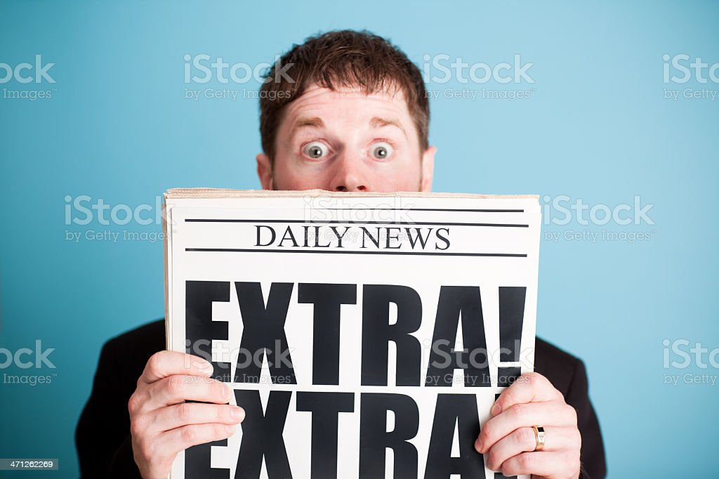 Surprised Businessman Holding Newspaper with Extra! Headline royalty-free stock photo