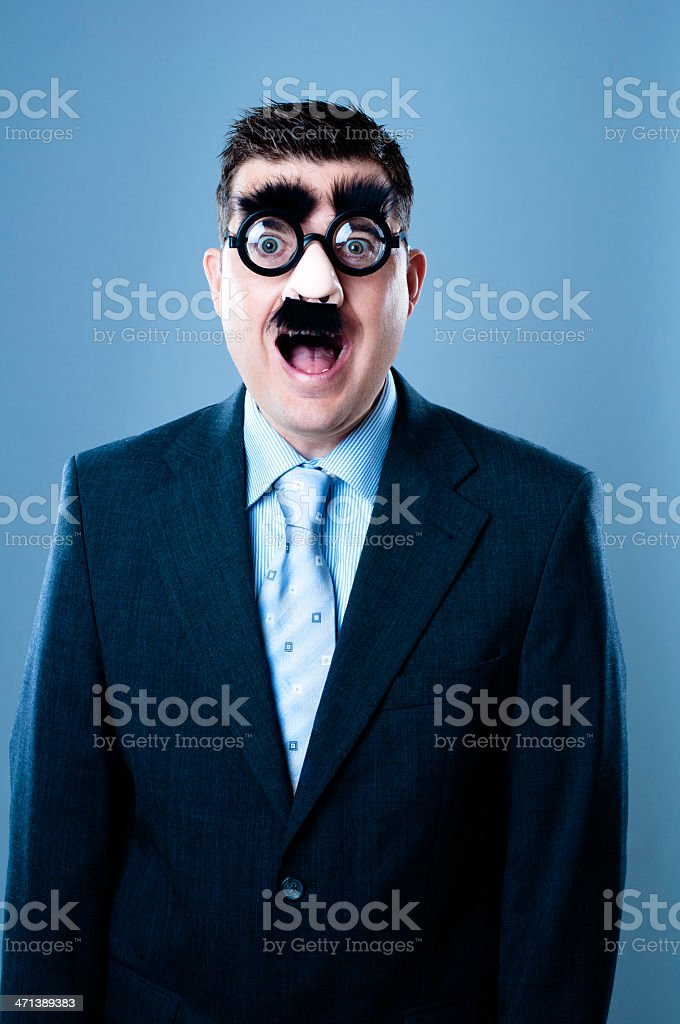 Surprised businessman in disguise stock photo