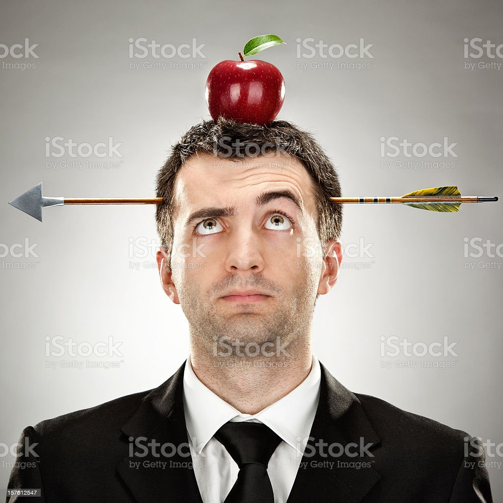 surprised businessman red apple on head hit by arrow royalty-free stock photo