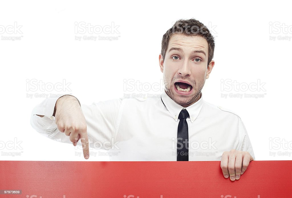 Surprised businessman with red sign royalty-free stock photo