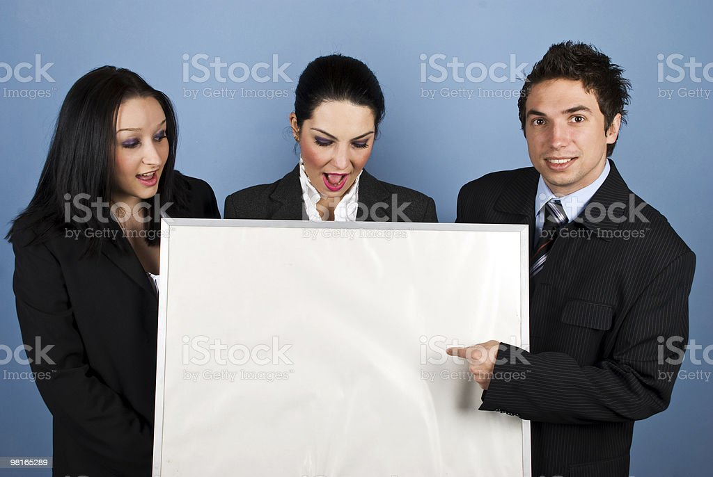 Surprised businesspeople with blank sign royalty-free stock photo