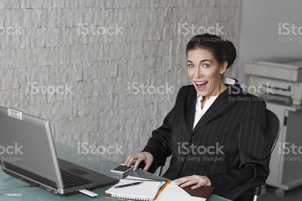 Surprised businesswoman at office royalty-free stock photo