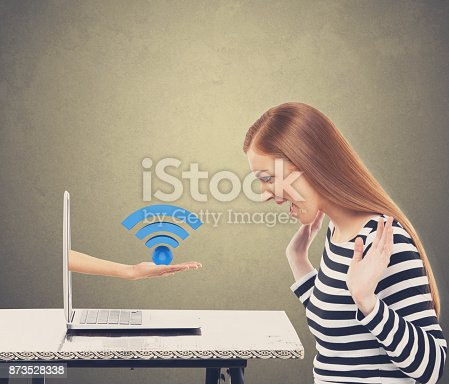 istock Surprised businesswoman with wireless icon 873528338