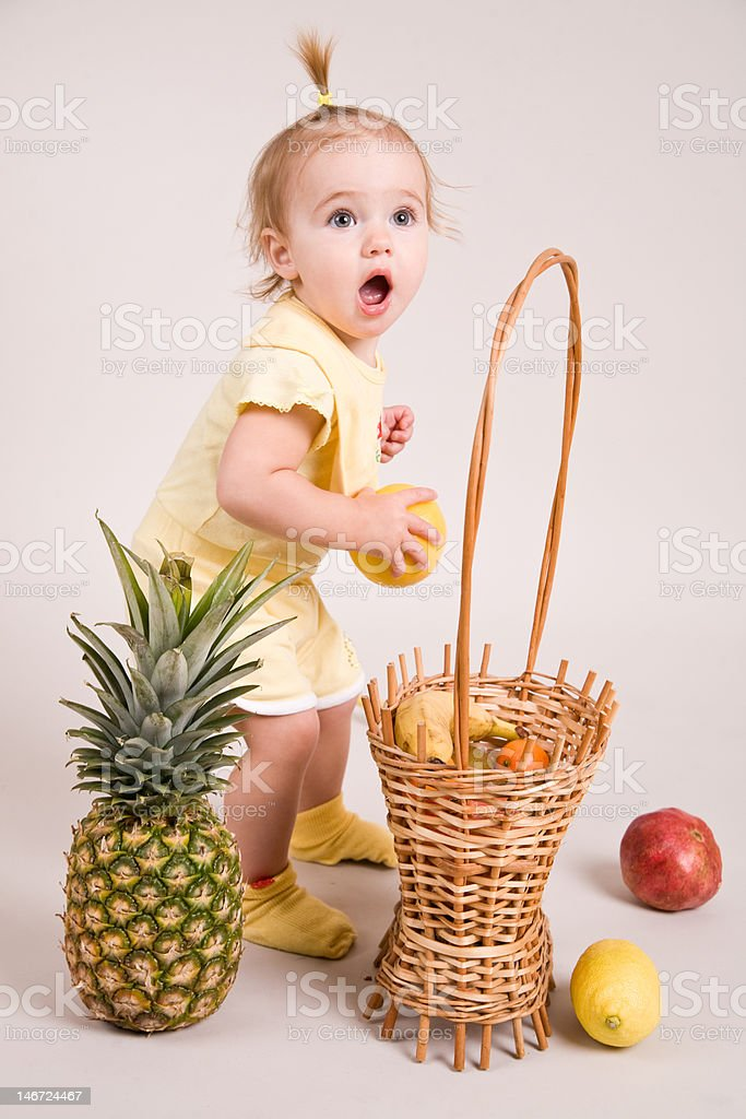 surprised child with fruits in studio royalty-free stock photo