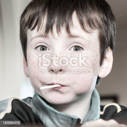 portrait of surprised children eating lollipop in vintage view
