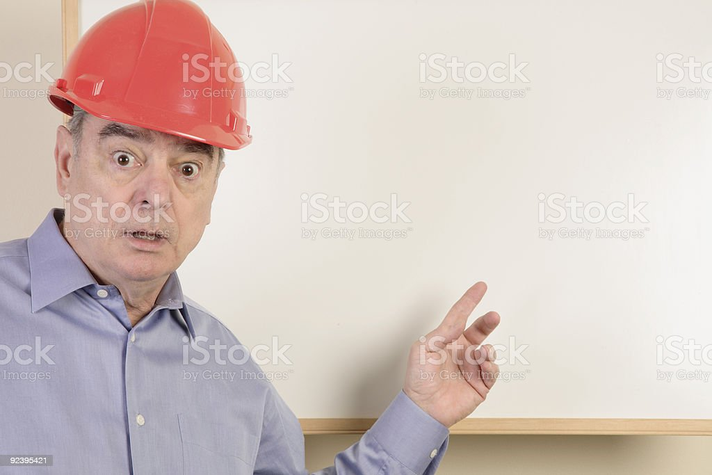 Surprised construction guy presenter royalty-free stock photo