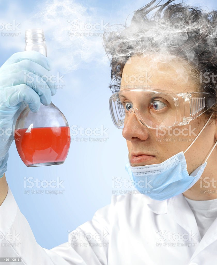 Surprised crazy scientist with flask stock photo