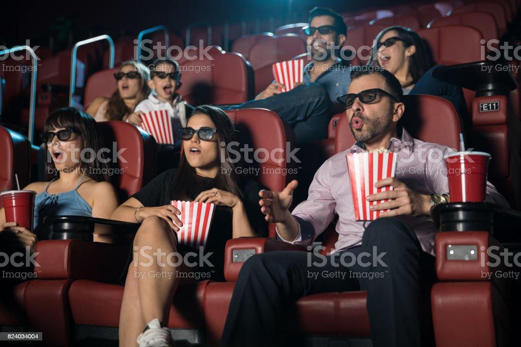 Surprised crowd watching 3d movie stock photo
