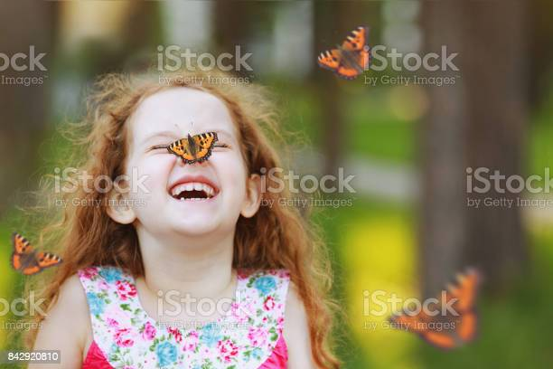 Surprised curly girl with a butterfly on his nose picture id842920810?b=1&k=6&m=842920810&s=612x612&h=n3xet edqihlcyoqbju6pfh94jqdys8e7endcubwigi=